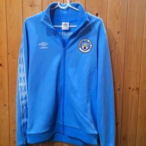 Manchester City team jacket.